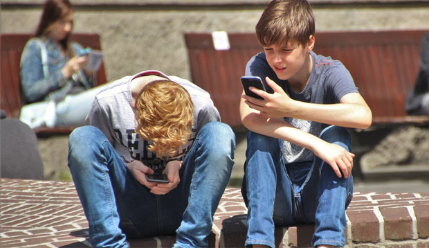 5 Questions To Answer Before You Buy Your Child A Phone